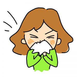 鼻を噛む女性